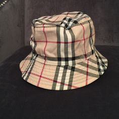 97a8ed224ff92 Authentic Burberry Reversible Bucket Hat Black on one side then switch to  plaid on the other! 2 hats in Great condition- stain free!