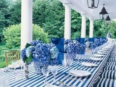 Striking blue and white tablescape with blue hydrangea centerpieces - Carolyne Roehm