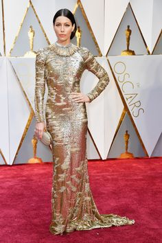 Jessica Biel is a dream in gold in this Kaufman Franco gown. #Oscars2017 #OscarLooks