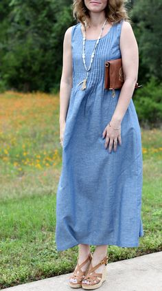When it comes to the summer heat, a maxi dress is the perfect companion. This Chambray maxi dress features a pintucked waist, which helps this style to not come across as boxy and it gives your body some definition. You can go casual and wear it with a pair of wedge sandals or dress it up a bit and add strappy heels. The great feature about this maxi dress outfit is it doesn't require much thought to put together a super cute summer outfit.