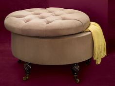 Brass casters make this ottoman mobile, while the tufted top and curved wood feet give it a luxurious feel. From @frontgate