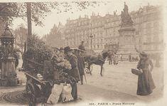 Une marchande de fleurs à côté d'une fontaine Wallace, place de Clichy (parfois appelée place Moncey), vers 1900.