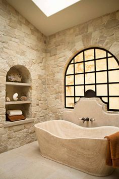 Love the built in shelves and the walls... Elegant Mediterranean bathroom in beige with limestone tiles, pantone warm sand, light beige, light tan