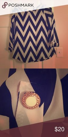Adorable chevron top with accent buttons! Black and white chevron with cute buttons on sleeves. In great condition! Everly Tops