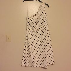 Carolina Herrera dress This cream and black polka dot dress is so hard to part with! It's a one shoulder A-line dress with a hidden zipper on the side. I bought it on a sight that only sells high end and never had an occasion to wear it! Carolina Herrera Dresses