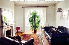 wide living room, rug and arching lamp