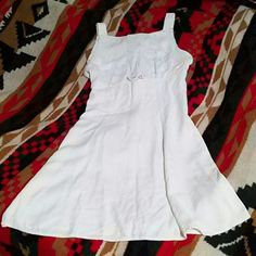 Teeze Me dress Solid white with light embroidery on upper body of dress. Empire waist. Zips in the back. Tie belt in back. Says it's a size 13 but this dress fits like a 6!!! Please take this into consideration when ordering! Hits just above the knee. Good condition. No stains. Teeze Me Dresses Midi