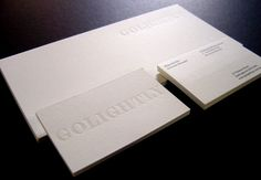 GOLIGHTLY Business card & With comps printed offset solid spot oclour on 2 sides with black text printed on 1 side. Pearl clear gloss foil applied to the logo with punch on Superfine Eggshell Ultra white 352gsm card. Designed by Studio Ultraviolet.
