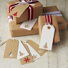 CHRISTMAS GIFT WRAPPING IDEAS: cut a coordinating design from your Christmas wrapping paper and attach them to your generic tags, or punch a holiday design directly into the tag. Numerous gift wrap suggestions shown. Christmas Gift Wrapping, All Things Christmas, Xmas Gifts, Christmas Presents, Craft Gifts, Christmas Holidays, Diy Gifts, Homemade Christmas, Christmas Christmas