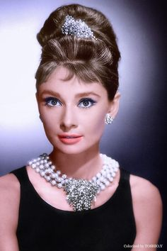 Audrey Hepburn. Classy lady...but where did she get my necklace? ;)