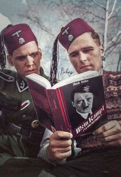 Soldiers of the 13th Waffen Mountain Division of the SS reading Mein Kampf 1943-45