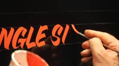 Master pinstriper Glen Weisgerber demonstrates the single stroke lettering technique. Weisgerber teaches pinstriping and lettering at the Airbrush Getaway Workshops.