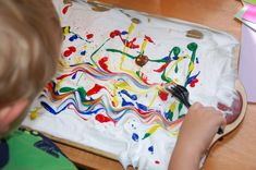 Shaving cream painting was a big hit at our house!!  I featured it in my 2nd article for WRAL Go Ask Mom which was posted last night: Shaving Cream Painted E