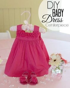 I've had so many inquires on how I was able to get the dresses to stand up for my Sweet Beginnings Baby Shower centerpieces so today I'm sharing the baby dress centerpiece tutorial.