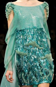 little mermaid fun evening party dress in gentle sparkling aquas and greens love the silk chiffon front panel and sleeve and sequin embellished shoulder epilettes alice could charm the walrus in this maybe its been made from her room of tears