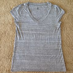 Gray V Neck Tee Stretchy and soft heather gray v neck tee.  95% rayon, 5% spandex.  Like new condition except a tiny hole in the underarm which I think might be from ripping the tag out. Mossimo Supply Co Tops Tees - Short Sleeve
