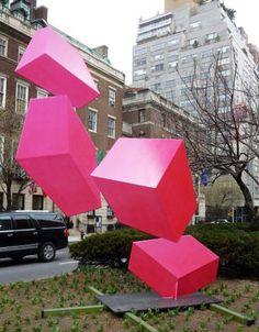 amazing sculpture on park ave: http://www.samanthahahn.com/blog/2012/03/18/raphael-barrios-optical-illusion-sculptures/