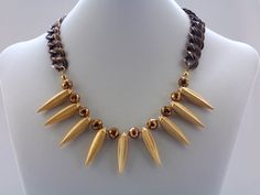 Necklace Matte gold Metal spikes mixed with by jwlrywrkroom