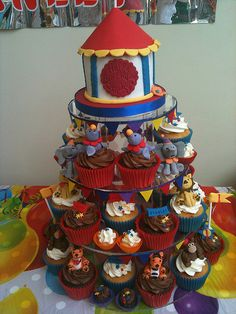 Google Image Result for http://www.thecupcakeblog.com/wp-content/uploads/2011/05/Circus-Cupcake-Tower.jpg