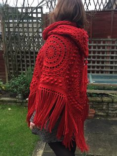 A really gorgeous seventies style hippy chic poncho. 6 individual crocheted, textured granny squares in fabulous red, edged right the way round with a lovely long fringe. The hood is made using 2 squares and finished with a tassel on the top point. Adult One Size Machine wash 30 degrees