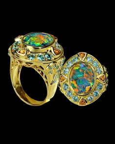 """Monet's Water Lilies"" black opal ring with garnets and zircons by Crevoshay:"