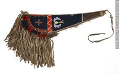 Crupper. Northern Plains. Niisitapiikwan (Kainai). 1865-1920, 19th century or 20th century Stroude, cotton cloth, tule? cloth, hide, glass beads, metal cones, thread 59 x 123.5 cm Purchased by the McCord Museum of Canadian History. © McCord Museum