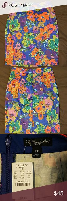 """J.Crew Printed Pencil Skirt J.Crew Factory Floral Printed Pencil Skirt, style 37532 *Navy blue background with red/purple/green flowers *98% Cotton & 2% Spandex, so fits perfectly! *Size 00 * Waist 13.5"""" across, Hip 17"""" across, Length 20"""" *NWT J. Crew Factory Skirts Pencil"""