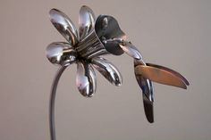 "Bell flower with Hummingbird  The spoon Flower ""blossomed"" from a discarded spoon and the desire to create art from found objects.    Now, after almost ten years of flatware sculpture, the possabilities are endless. You never know what you might see when you visit our booth or studio."