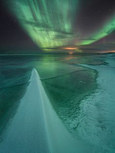"""Snow Dagger"" - aurora borealis over frozen snow-covered lake near Vik Iceland - © Örvar Atli Þorgeirssonaurora - http://1x.com/photo/46740/"