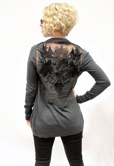 Tutorials   Urban Threads: Create a big & bold embroidery statement by tying totally different designs together with color, then floating them on the open back of a cardigan for a chic and sexy look