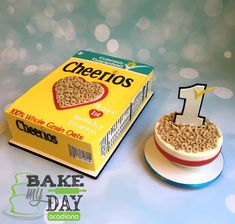 3D Cheerios cereal theme first birthday party! Buttercream covered cereal box and smash cake bowl with fondant decorations.