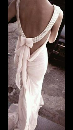 Gorgeous pearl detailing on a gown; sexy yet sophisticated!