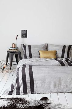 shades of grey with stripes and painted floorboards, love gold cushion to set it all off