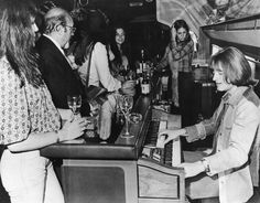 John Paul Jones playing organ & his wife, Maureen, to the left in front of him.