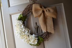 I could add a burlap bow to my hydrangea wreath that's already on my door... :)