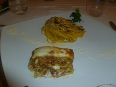 Lasagna Verde Bolognese (Green spinach lasagna with Bolognese meat sauce and Bechamel) and freshly made pasta with Bolognese meat sauce at Pappagallo in Bologna, Italy.