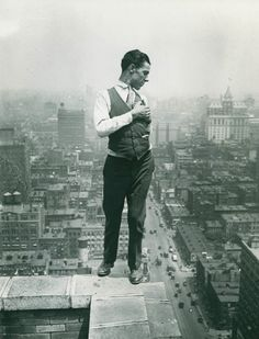 Man on the roof of a building In The US (1930s).