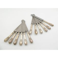 A set of twelve Victorian silver New Gothic pattern table knives, by George Adams, London 1872, re-bladed. (12