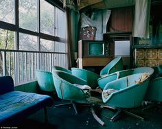 Bygone era: A smattering of green leather chairs and a vintage television clutter a hotel lounge. Izu peninsula, Japan.