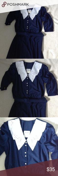 Vintage navy dress Vintage navy dress with eyelet trim and faux-pearl buttons that are fully operational. Detachable navy belt, belt does not have any belt loops on the dress. Attached shoulder pads. 48 inches in length, 3/4 sleeves Sue Sherry Dresses Midi