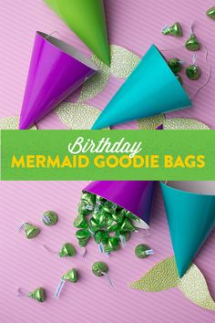 DIY Birthday Mermaid Goodie Bags — Here's a KISS-ational goodie bag that will have all of your child's friends under the sea singing about the tasty party favors swimming inside. What you'll need: HERSHEY'S Birthday candy, colored party hats, textured craft paper and adhesive. Cut the craft paper in the shape of a fin, glue to the hat, fill, and the bag is ready to take a swim! Let's make your child's party the sweetest celebration ever, with HERSHEY'S Birthday candy. Let's Birthday!