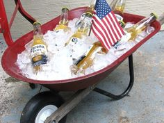 Wheel barrow ice bucket. I did this for my son's baptismal party with wine and champagne! Great idea for a bbq!