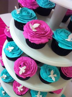 turquoise fuschia cupcakes | Fuchsia and tursquoise wedding cupcakes. Rose shaped frosting with ..