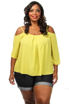 This classy plus size top features a solid body, open shoulder 1/2 sleeve and loose bottom. Soft, non-stretch material 100% Polyester Model wearing 3X Made in USA