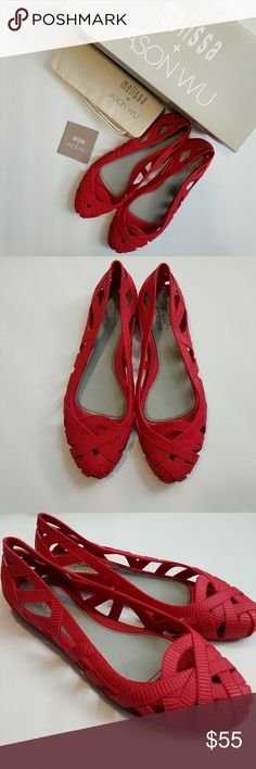 Jason Wu + Melissa red flats Jason Wu + Melissa red flats size 6. Only wore a few times. Still in good condition. Comes with bag and box. Melissa Shoes Flats & Loafers