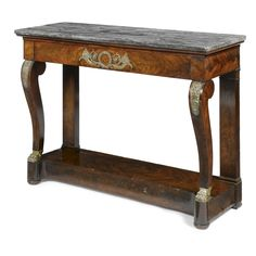 A gilt-brass-mounted mahogany console table<br>Restauration, circa 1825 | lot | Sotheby's