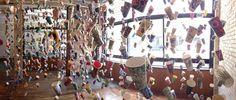 1001 Coffee Cup Stories by Gwyneth Leech, interior view, the Harris Building. 25 feet w x 10 feet h x 10 feet d. Each cup is an individual handmade artwork. Vote Code: 56642.