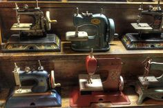 Vintage toy sewing machines.