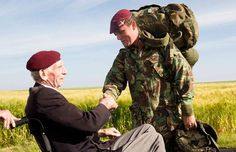 #DDay Private Douglas Baines, a veterans of the Parachute Regiment who jumped on 6th June 1944 and who liberated Ranville, greets a member of the Parachute Regiment who took part in the memorial jump