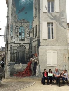 In Saint André Square, in the historic center of Old Angoulême, is Memoires du XXeme Ciel (Memories of the 20th Heaven) by Bernard Hislaire, better known by the pseudonym Yslaire. The 1999 mural shows scenes of his acclaimed graphic novel project of the same name. The scene of the man and woman kissing is a moment taken from Yslaire's French Revolution saga Sambre, about the forbidden romance between an aristocrat and a farm girl. Above them are biplanes and an angel, other images from the…